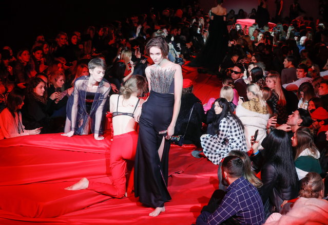 Models present a creation by Ukrainian brand FROLOV during the Ukrainian Fashion Week in Kiev, Ukraine, 01 February 2019. (Photo by Sergey Dolzhenko/EPA/EFE)
