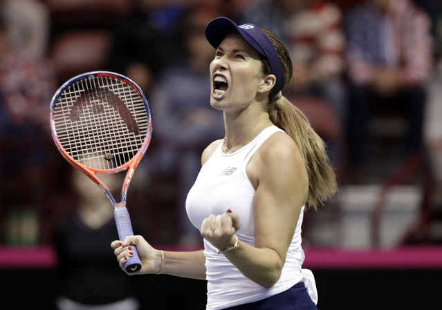 United States' Danielle Collins reacts after a shot from Australia's Daria Gavrilova during their first-round Fed Cup tennis match in Asheville, N.C., Sunday, February 10, 2019. (Photo by Chuck Burton/AP Photo)