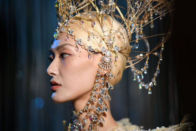 A model prepares backstage before the Heaven Gaia Collection show by designer Xiong Ying  during the China Fashion Week Spring/Summer 2022 Collection at the 751D.PARK on September 03, 2021 in Beijing, China. (Photo by Yanshan Zhang/Getty Images)