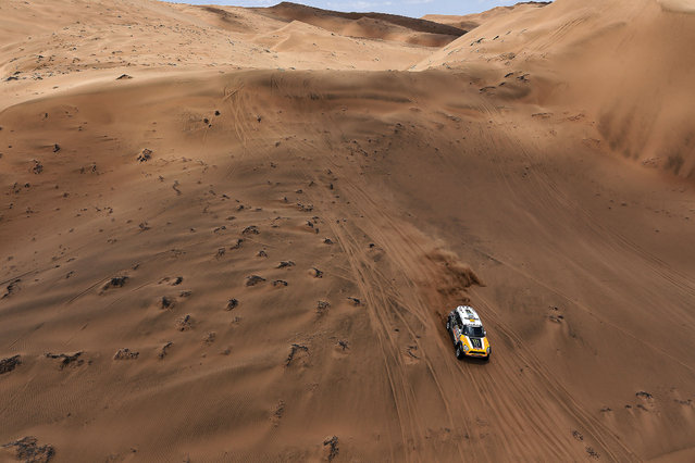 Mini driver Orlando Terranova, of Argentina, and co-pilot Paulo Fiuza, of Portugal, race through the dunes during the twelfth stage of the Dakar Rally between the cities of El Salvador and La Serena, Chile, Friday, January 17, 2014. (Photo by Frederic Le Floch/AP Photo)