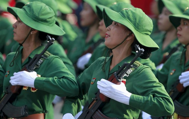 Vietnamese female soldiers march during a rehearsal for a military parade as part of the 40th anniversary of the fall of Saigon in southern Ho Chi Minh City (formerly Saigon City), Vietnam, on April 26, 2015. (Photo by Reuters/Kham)