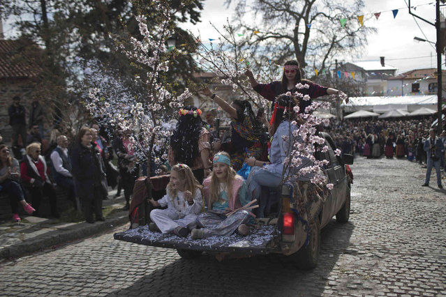 Participants in a Clean Monday festival in the village of Sohos ride in a pick-up truck on Monday, March 11, 2019. The procession is one of a great variety of customs across Greece. Celebrating the beginning of Lent it is rooted in the ancient past, many, experts believe, celebrating fertility. (Photo by Petros Giannakouris/AP Photo)