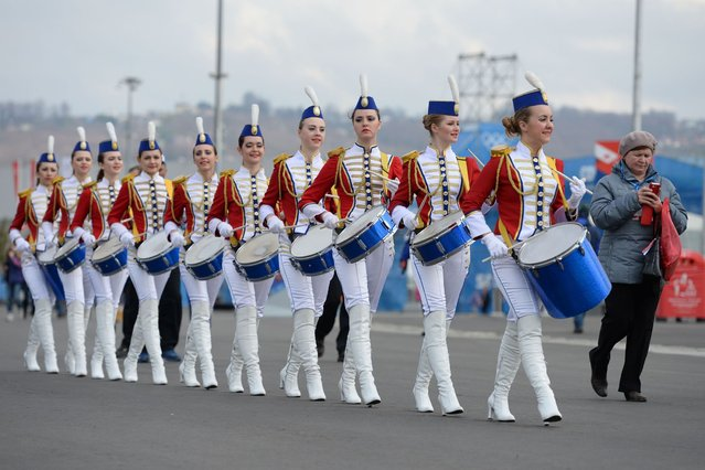 A Russian band plays at the seaside cluster during the Sochi Winter Olympic Games on February 11, 2014. (Photo by Andrej Isakovic/AFP Photo)