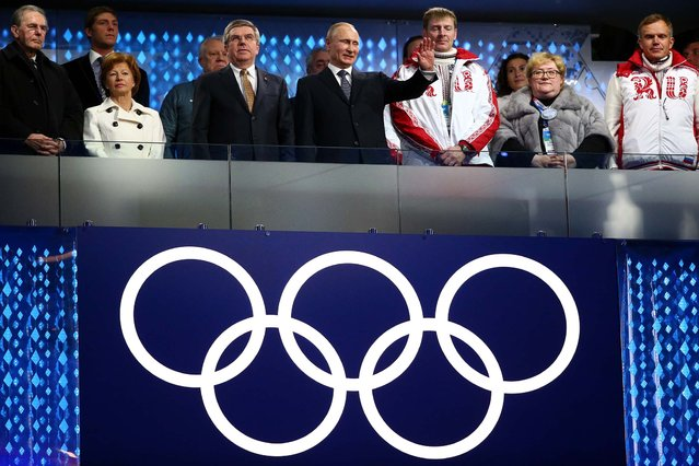 (L-R) Former President of the International Olympic Committee (IOC) Jacques Rogge, Claudia Bach, International Olympic Committee (IOC) President Thomas Bach and President of Russia Vladimir Putin look on during the closing ceremony. (Photo by Ryan Pierse/Getty Images)