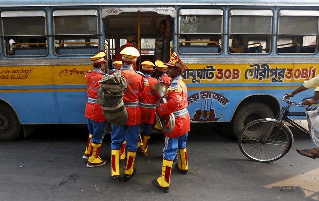 Band members board a passenger bus on their way to perform at a wedding procession in Kolkata, India, March 10, 2016. (Photo by Rupak De Chowdhuri/Reuters)