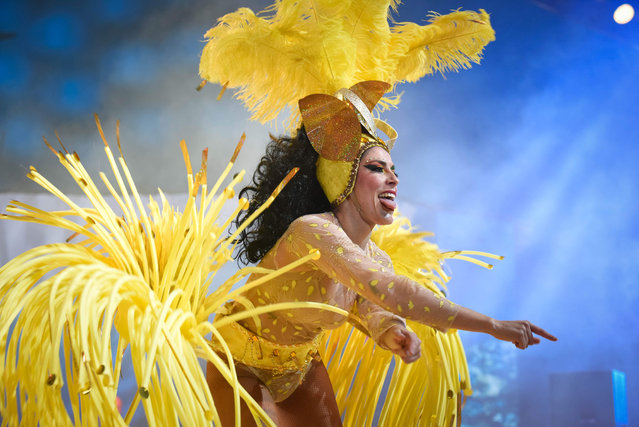 A dancer performs on the main stage in the Battle of the Troops contest during carnival celebrations in Santa Cruz de Tenerife, on the Spanish Canary island of Tenerife, on February 18, 2017. The over month long event began on February 1 and finishes on March 5 with orchestras playing Caribbean and Brazilian rhythms throughout the festivities that range from the election for the Carnival Queen, the Junior Queen and the Senior Queen, children and adult murgas (satirical street bands), comparsas (dance groups) to performances on the streets. (Photo by Desiree Martin/AFP Photo)
