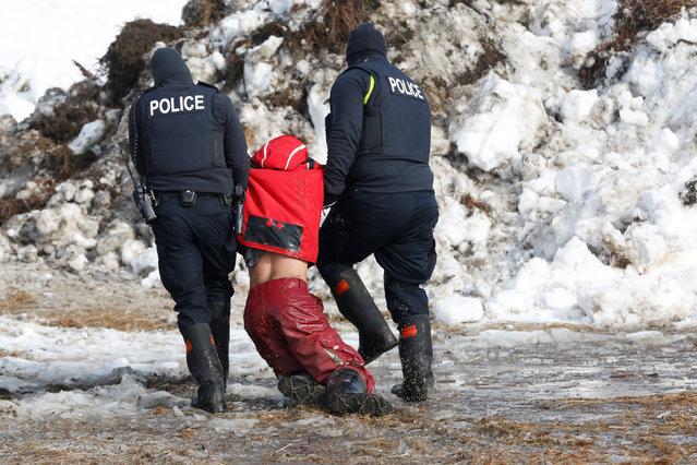 Police detain Ricardo Salazar, 25, of San Bernardino, California, in the main opposition camp against the Dakota Access oil pipeline near Cannon Ball, North Dakota, U.S., February 23, 2017. (Photo by Terray Sylvester/Reuters)
