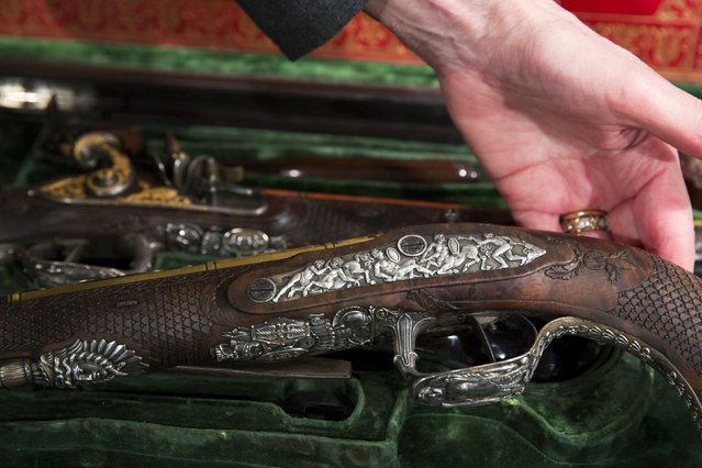 Details of a pistol set made by Versailles gunsmith Nicolas-Noel Boutet and was gifted to Simon Bolivar from Marquis de La-fayette are displayed at Christie's auction house in the Manhattan borough of New York, April 5, 2016. (Photo by Lucas Jackson/Reuters)