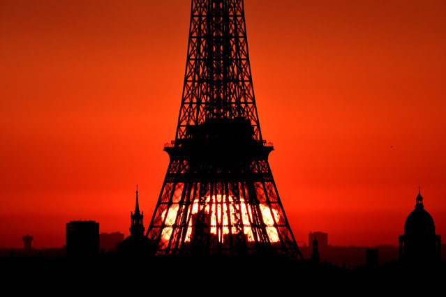 Sun rises in the sky behind the Eiffel Tower as seen from Suresnes in Paris, France on March 1, 2019. (Photo by Mustafa Yalcin/Anadolu Agency/Getty Images)