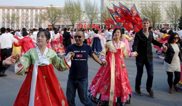 People dance on the anniversary of the birth of North Korea's founding leader Kim Il Sung in this undated photo released by North Korea's Korean Central News Agency (KCNA) in Pyongyang April 15, 2016. (Photo by Reuters/KCNA)