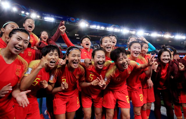 China's players celebrate their victory at the end of the France 2019 Women's World Cup Group B football match between South Africa and China, on June 13, 2019, at the Parc des Princes stadium in Paris. (Photo by Gonzalo Fuentes/Reuters)