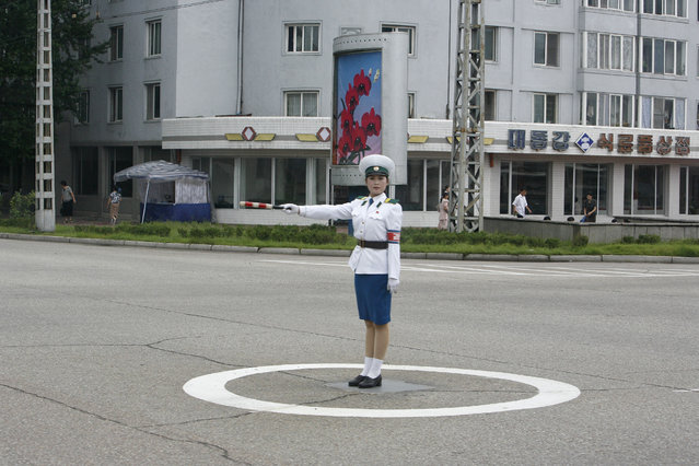 A North Korean traffic policewoman stands on a road in Pyongyang August 27, 2007. (Photo by Reinhard Krause/Reuters)