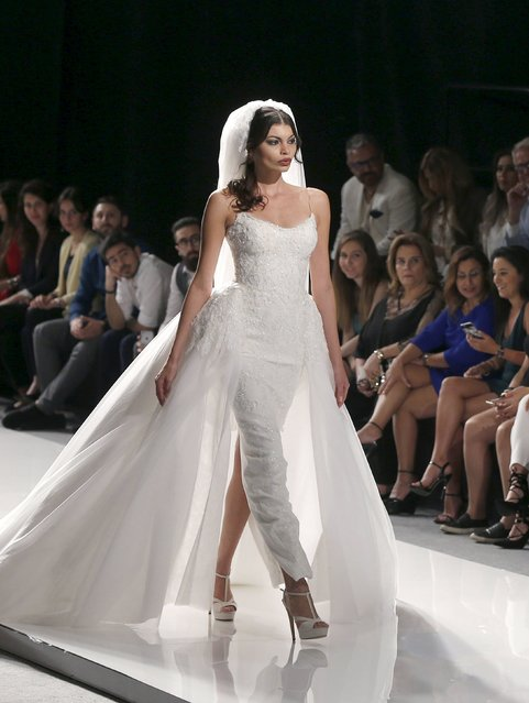 A model displays a wedding dress from Spring/Summer 2016 Haute Couture collection by Lebanese designer Abed Mahfouz during the Beirut Fashion Week in Beirut, Lebanon April 19, 2016. (Photo by Mohamed Azakir/Reuters)