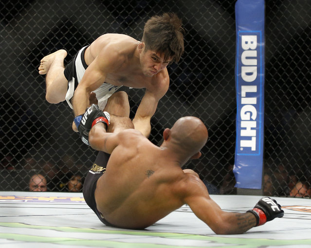 Demetrious Johnson, right, fights Henry Cejudo during a flyweight championship mixed martial arts bout at UFC 197, Saturday, April 23, 2016, in Las Vegas. (Photo by John Locher/AP Photo)
