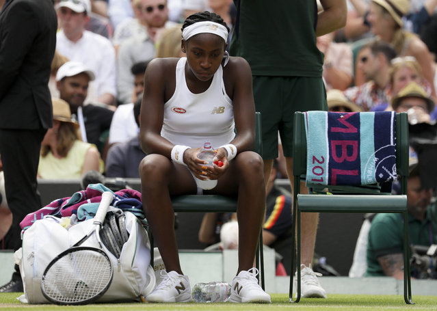 "United States' Cori ""Coco"" Gauff is dejected after losing to Romania's Simona Halep in a women's singles match against on day seven of the Wimbledon Tennis Championships in London, Monday, July 8, 2019. (Photo by Kirsty Wigglesworth/AP Photo)"