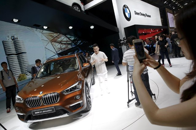 People gather around a long wheelbase BMW X1 xDrive25Li after it was presented during the Auto China 2016 auto show in Beijing April 25, 2016. (Photo by Damir Sagolj/Reuters)