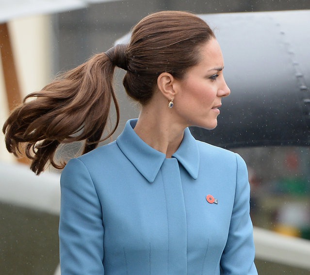 Britain's Catherine, Duchess of Cambridge looks at a static WWI display, with her husband Prince William (unseen), at the Omaka Aviation Heritage Centre near Blenheim, in New Zealand April 10, 2014. The Prince and his wife Kate are undertaking a 19-day official visit to New Zealand and Australia with their son George. (Photo by Anthony Devlin/Reuters)