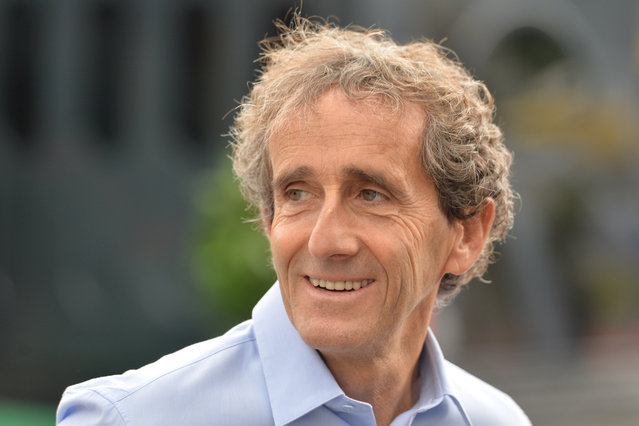 Four-time Formula One champion Alain Prost visits the paddock area prior to the Austrian Formula One Grand Prix race at the Red Bull Ring in Spielberg, southern Austria, Sunday, June 21, 2015. (AP Photo/Kerstin Joensson)