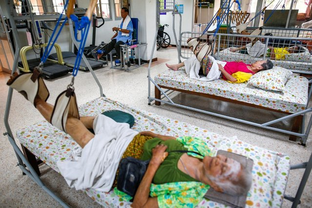 Elderly people lie in beds during a physical therapy session at Bangkhae Home Foundation in Bangkok, Thailand, April 27, 2016. (Photo by Athit Perawongmetha/Reuters)