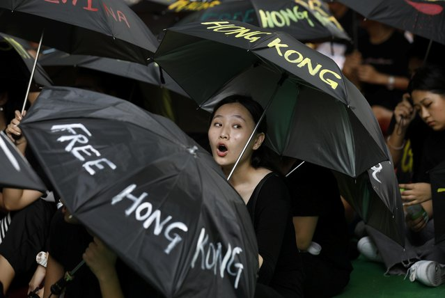 A Tibetan exile shouts slogan during a protest to support Hong Kong pro-democracy protestors, in New Delhi, August 30, 2019. (Photo by Adnan Abidi/Reuters)