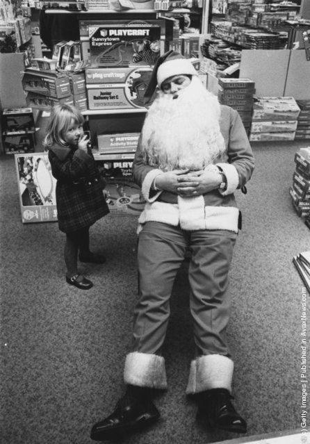 1976: A young girl finds Father Christmas asleep at Bourne And Hollingsworth store in Oxford street, London