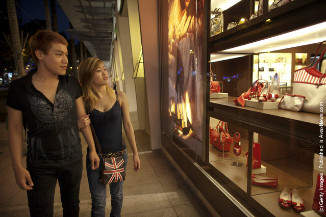 A Vietnamese couple  gazes at the luxury items on sale at a brand new luxury mall
