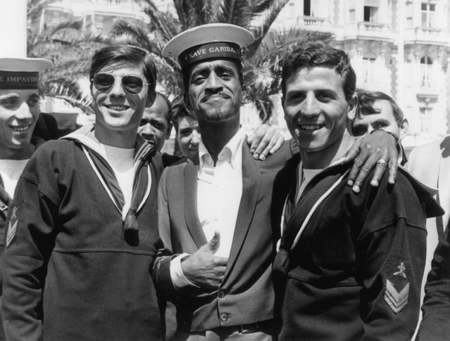 "Actor Sammy Davis Jr. poses in a borrowed cap, from a group of Italian sailors, during the Cannes Film Festival, May 5, 1966, in France. Davis was there to promote his film ""A Man called Adam"". (Photo by RDA/Hulton Archive/Getty Images)"