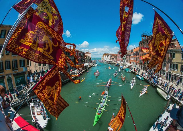 Rowers enter in Canaregio river during the 42nd Venice Vogalonga on May 15, 2016 in Venice, Italy. 42 years ago a group of Venetians, both amateur and professional rowers, came up with an idea of non-competitive race in which any kind of rowing boat can take part. The first Vogalonga began with the message to protest against the growing use of powerboats in Venice and the swell damage they do to the historic city. (Photo by Awakening/Getty Images)