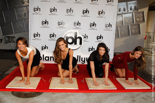 (L-R) SI swimsuit models Chrissy Teigen, Izabel Goulart, Crystal Renn and Nina Agdal attend the SI Swimsuit Models Planet Hollywood handprint ceremony at Planet Hollywood