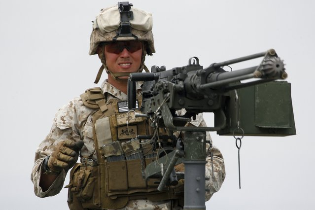 "US marine controls his machine gun during a joint military exercise with NATO members, called ""Agile Spirit 2015"" at the Vaziani military base outside Tbilisi, Georgia, July 21, 2015. (Photo by David Mdzinarishvili/Reuters)"
