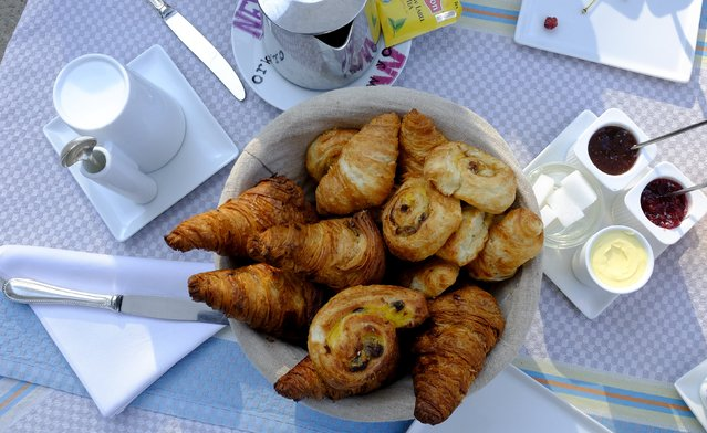 Croissants sit on a table at a hotel before the 11th stage of the 102nd Tour de France cycling race from Pau to Cauterets in the French Pyrenees mountains, France, July 14, 2015. (Photo by Stefano Rellandini/Reuters)