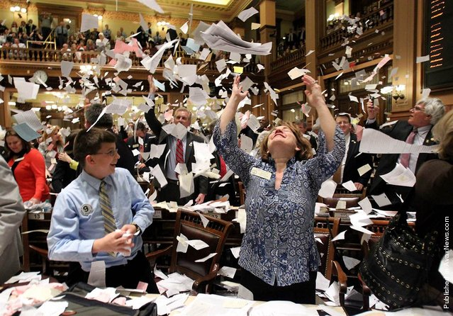 "Georgia state Rep. Donna Sheldon, R-Dacula, throws paper into the air next to Thomas Allison after House Majority Leader Rep. Larry O'Neal yelled, ""Sine Die"". The proclamation, from the Latin ""without day"", ended the 2012 Legislative session at midnight at the Capitol in Atlanta, Ga., March 29, 2012"