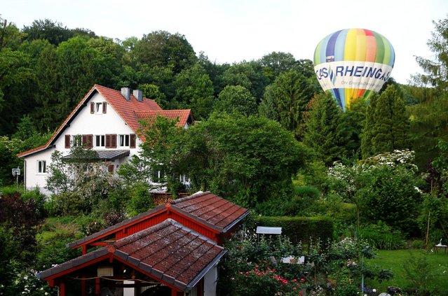 A balloon driver mistankingly lands in a garden in Bad Honnef near Bonn, western Germany June 10, 2016. (Photo by Wolfgang Rattay/Reuters)