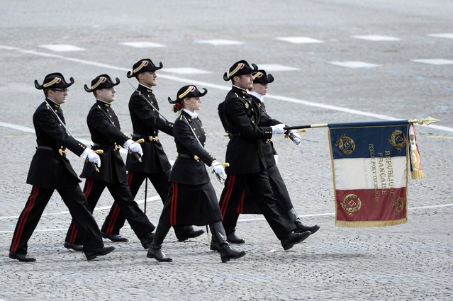 Students of the special military school of Polytechnique parade on July 14, 2014 on the Champs Elysees avenue in Paris during the annual Bastille Day military parade. (Photo by Stephane De Sakutin/AFP Photo)