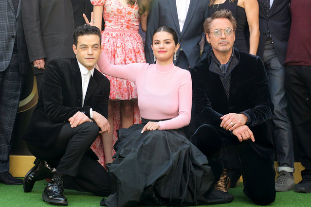 """Selena Gomez gets silly with her """"Dolittle"""" co-stars Rami Malek (left) and Robert Downey Jr. at Regency Village Theatre, Los Angeles, USA on January 11, 2020. (Photo by Chelsea Lauren/Variety/Rex Features/Shutterstock)"""