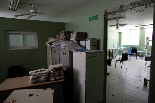 Folders lie unattended next to an empty room at The Peace (La Paix) Hospital, which is one of the centers affected by a three-month-long strike by health workers demanding a pay rise and resources, in Port-au-Prince, Haiti, June 22, 2016. (Photo by Andres Martinez Casares/Reuters)