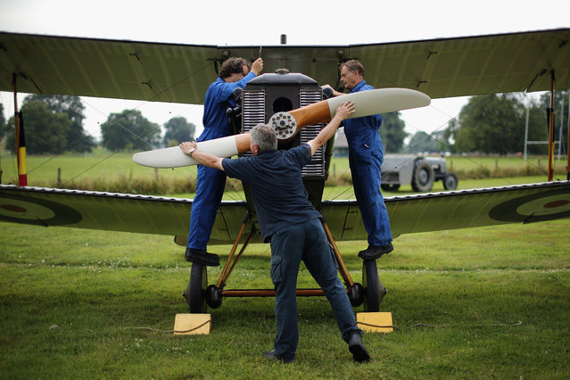 """The SE5a is prepared for demonstration flight at """"The Shuttlesworth Collection"""" at Old Warden on July 21, 2014 in Biggleswade, England. Of the 55,000 planes that were manufactured by the Royal Army Corps (RAC) during WWI, only around 20 remain in airworthy condition. (Photo by Dan Kitwood/Getty Images)"""