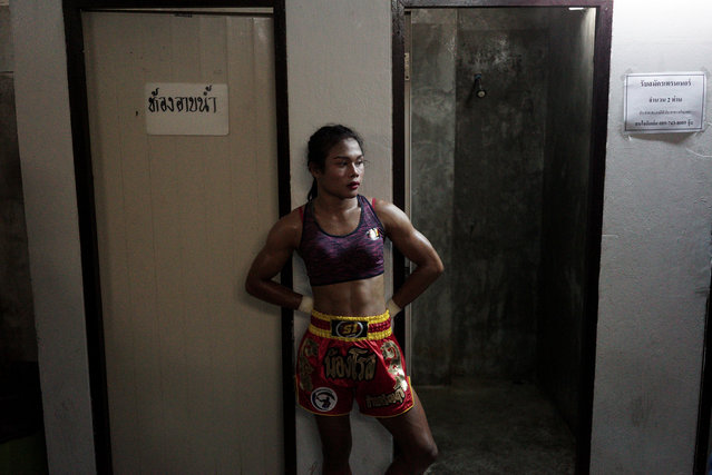 """Muay Thai boxer Nong Rose Baan Charoensuk, 21, who is transgender, waits before her boxing match at the Rajadamnern Stadium in Bangkok, Thailand, July 13, 2017. The 21-year-old started boxing at eight, following in the footsteps of an uncle, a Muay Thai fighter who encouraged her to train. Her twin brother is also a Muay Thai fighter. Born Somros Polchareon, Rose said she identified as a woman at an early age and began wearing makeup and a sports bra in the ring. In the rural towns where she has done most of her fighting, her appearance disconcerted some of her male opponents. """"They would say they didn't want to fight with a gay person, as it would be embarrassing if they won or lost"""", she said. """"I still face those insults, but I don't care about them"""". Thailand is widely seen as a paradise for gay and transgender people, but many say they are treated as second-class citizens. Transgender women figure on television, in beauty pageants and at hair salons and cosmetics counters, but they cannot change their gender designation on identity papers, despite a 2015 law against gender-based discrimination. After more than 300 fights, racking up 30 of her 150 wins through knockouts, Rose said she was finally allowed to fight at Rajadamnern Stadium in the Thai capital. Puttipong Plukram, the owner of the camp in the northeastern province of Buriram where Rose trains, calls her a """"great role model"""", citing her diligence in chores and training, and saying she often runs farther than anyone else. Rose is not Thailand's first transgender boxer. That was Parinya """"Nong Toom"""" Charoenphol, the subject of the 2004 film """"Beautiful Boxer"""". Toom eventually ran a boxing school and Rose someday hopes to do the same. Rose also aspires to be an ambassador for Muay Thai around the world, and urges transgender boxers in rural areas not to be discouraged by early setbacks. (Photo by Athit Perawongmetha/Reuters)"""