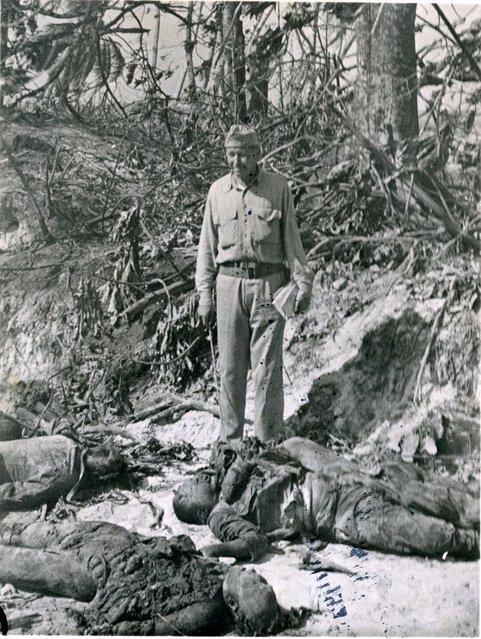 Captain Zacharias views dead Japs while fighting still rages