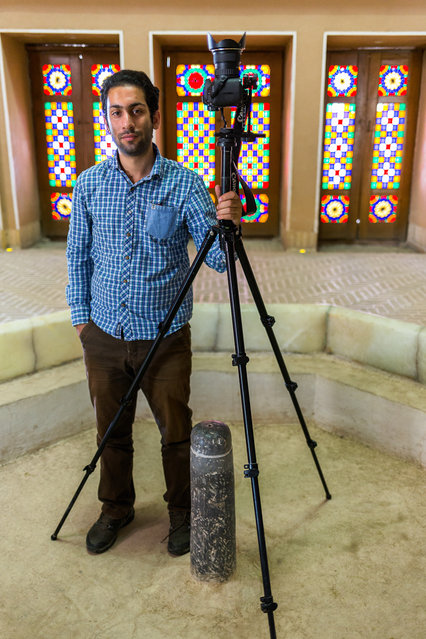 Mohammad Reza Domiri Ganji with his camera. (Photo by Mohammad Reza Domiri Ganj)