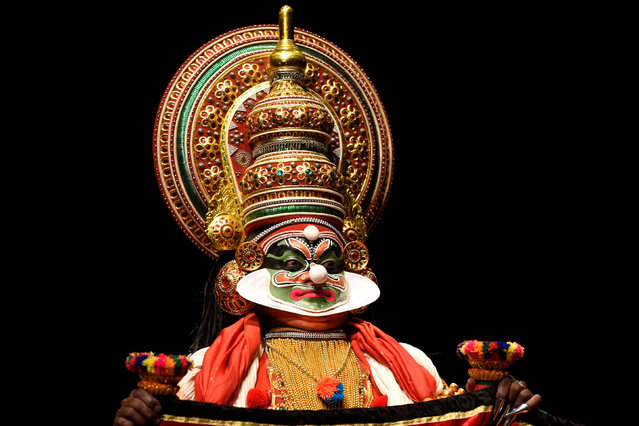 "A member of the Indian company Margi Kathakali theatre performs during ""Kijote Kathakali"", a Kathakali recital based on the Spanish classic ""Don Quixote"", at the Niemeyer Center in Aviles, northern Spain, July 29, 2016. (Photo by Eloy Alonso/Reuters)"