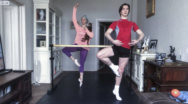 In this photo taken via online video call on Friday, April 17, 2020, Russian Bolshoi Ballet principal dancers Maria Alexandrova and Vladislav Lantratov attend an online training with their ballet partners at home in Moscow. Russians from many walks of life are struggling to adapt to working remotely because of the coronavirus outbreak. The shutdown has driven many businesses to the verge of collapse and made millions jobless, according to estimates. (Photo by Pavel Golovkin/AP Photo)