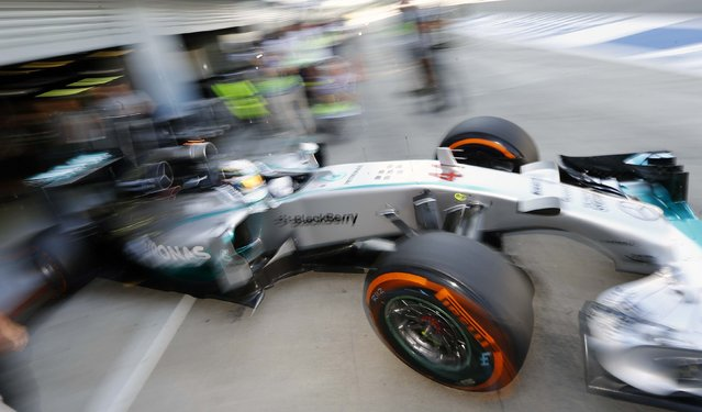 Mercedes Formula One driver Lewis Hamilton of Britain leaves the pit during the third practice session of the Italian F1 Grand Prix in Monza September 6, 2014. (Photo by Stefano Rellandini/Reuters)