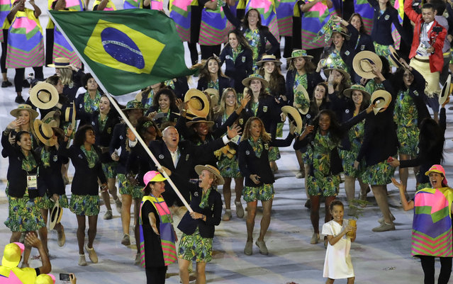 Yane Marques carries the flag of Brazil during the opening ceremony for the 2016 Summer Olympics in Rio de Janeiro, Brazil, Friday, August 5, 2016. (Photo by Patrick Semansky/AP Photo)