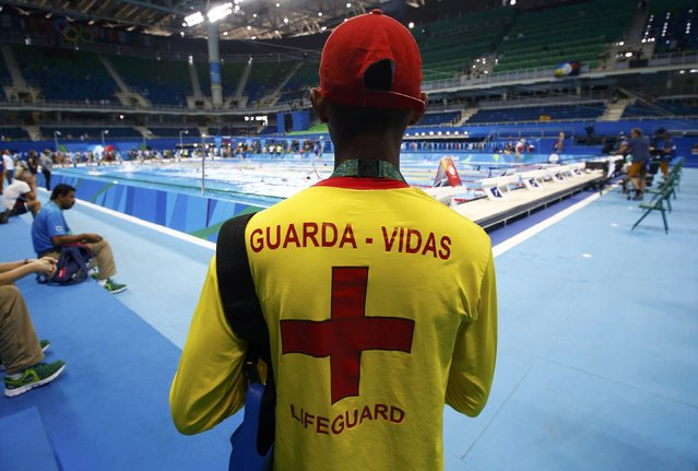 2016 Rio Olympics, Olympic Aquatics Stadium, Rio de Janeiro, Brazil on August 7, 2016. A lifeguard watches over swimmers in the Olympic pool. (Photo by David Gray/Reuters)
