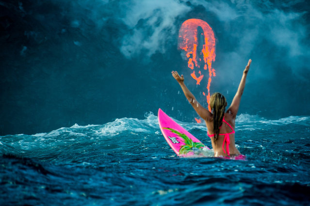 Professional adventurer Alison Teal has become the first woman to paddle out into lava during a volcanic eruption into the sea. Amazing shots of the extreme surf session shows the daredevil riding her pink surfboard up to the base of Kilauea Volcano. Photographer Perrin James snapped the brave explorer within feet of the lava as it flows into the ocean. Its the first the volcano in the Big Island of Hawaii has erupted since 2011. Here: Alison Teal paddles out to Kilauea volcano in Hawaii as it eruopts into the ocean. (Photo by Perrin James/Caters News)