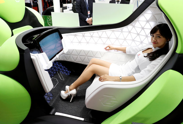 A model presents the Flesby, a one-seater mobility concept car, during a media preview of the 45th Tokyo Motor Show in Tokyo, Japan on October 25, 2017. (Photo by Kim Kyung-Hoon/Reuters)