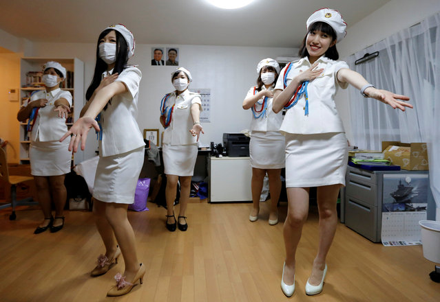 Chunhun (R), the leader of Japan's North Korea fan club called sengun-joshi, or military-first girls, and other members practice a Moranbong Band dance in Tokyo, Japan on November 2, 2017. (Photo by Toru Hanai/Reuters)