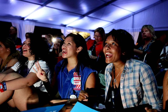 Lynn University students Estefanny Paulino of New York, Stefani Silva of Texas and Amanda Nguherimo of Maryland watch the debate at the Red, White and View party. (Photo by Gary Coronado/The Palm Beach Post)