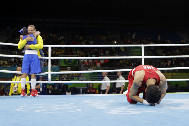 Thailand's Peamwilai Laopeam, right, bows to judges as Colombia's Ingrit Lorena Valencia Victoria celebrates after winning a women's flyweight 51-kg quarterfinals boxing match at the 2016 Summer Olympics in Rio de Janeiro, Brazil, Tuesday, August 16, 2016. (Photo by Jae C. Hong/AP Photo)
